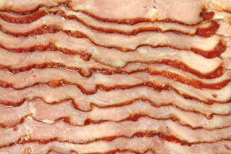 turkey bacon: A very close view of sliced turkey bacon. Stock Photo