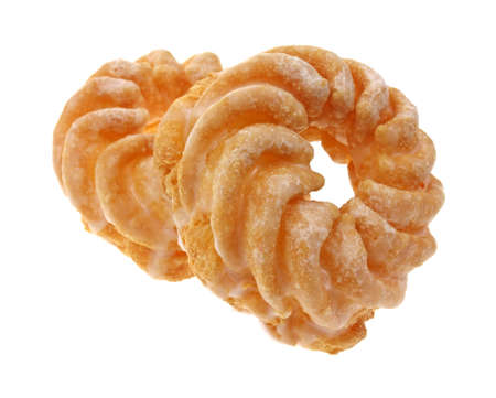 Two fluted crullers with one leaning atop the other against a white background. Stock Photo - 10873373