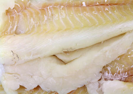 haddock: A very close view of fresh haddock pieces.