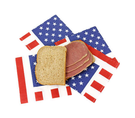 A wheat bread corned beef sandwich on several American flag napkins. Stock Photo - 10873386