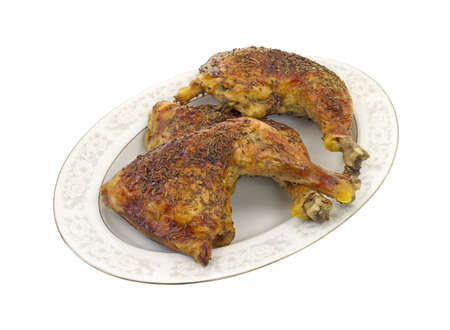 Three pieces of home baked chicken on a large platter.  photo