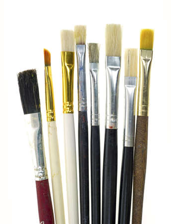 Several artist brushes that have been used on a white background.  Stock fotó