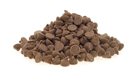 chocolate chips: A small pile of milk chocolate chips used for cooking on a white background.  Stock Photo