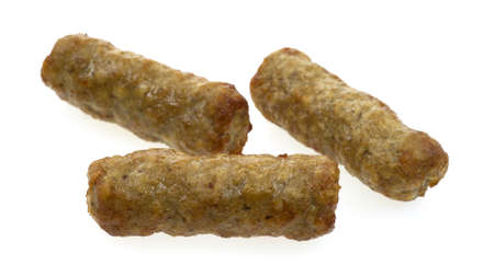 browned: Three cooked breakfast sausages arranged on a white background.