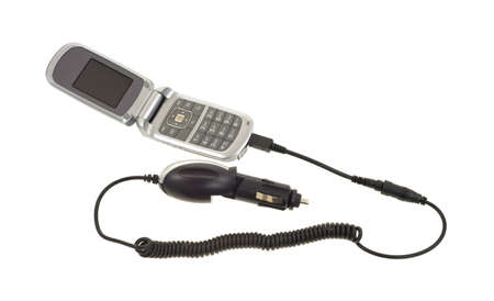 A cell phone with a car cigarette lighter adapter on a white background.