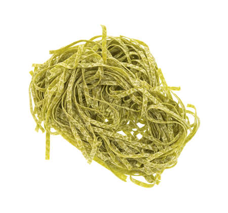 enriched: Top view of spinach flavored egg noodle pasta on a white background. Stock Photo