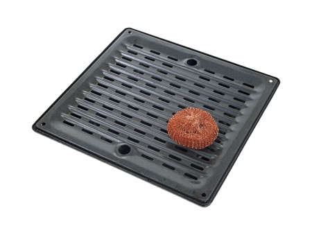 A copper scouring pad on a large broiler pan.