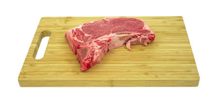 Side view of a t-bone steak on a wood cutting board. photo