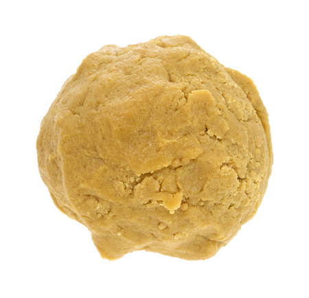 A large ball of cookie dough on a white background.