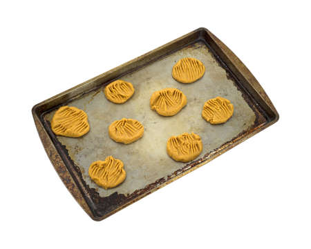 A group of unbaked peanut butter cookies on a baking pan. photo