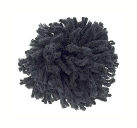 A single black pompom on a white background.