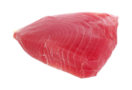 Side view of a fresh yellowfin tuna steak on a white background.