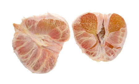pummelo: Two halves of a freshly peeled pummelo fruit on a white background.