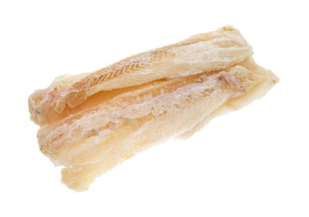 Side view of several large pieces of frozen pollock on a white background. photo