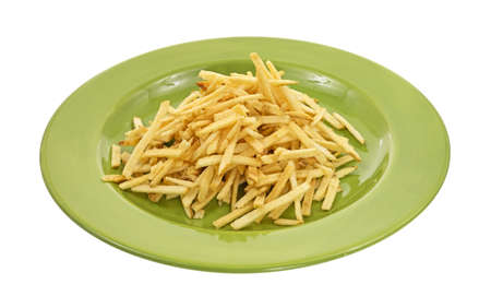 shoestring: Side view of a serving of shoestring potatoes on a green plate.