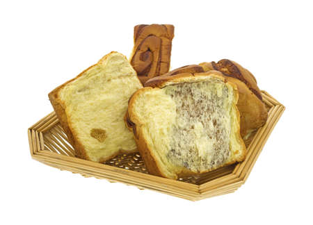 A loaf of cinnamon bread that has been pulled apart in a wicker basket