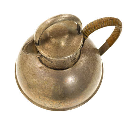 tarnished: Top view of an old silver plated teapot  with handle and spout on a white background