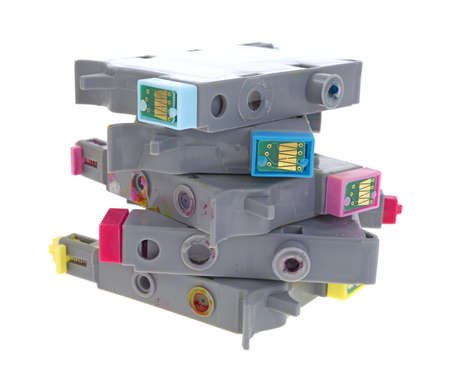 A jumbled stack of empty inkjet printer cartridges on a white background  photo