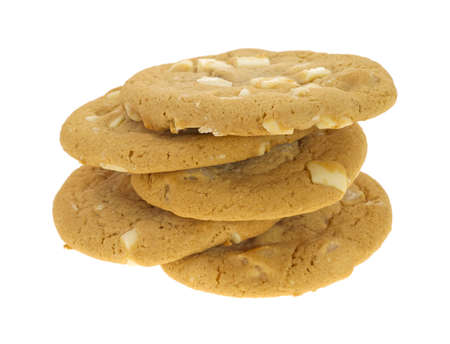 white chocolate: Five macadamia nut and white chocolate cookies in a sloppy stack on a white background  Stock Photo