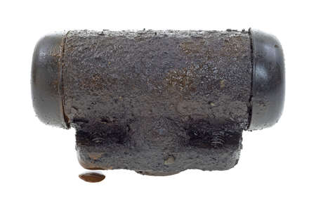 An old wheel cylinder that is leaking brake fluid on a white background   photo
