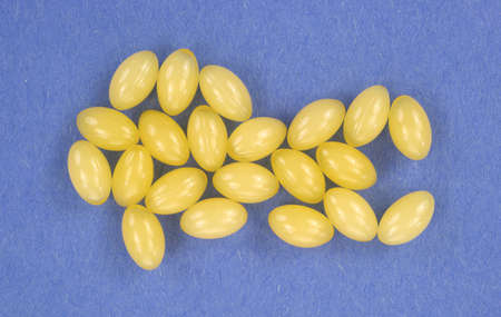 Top view of several aloe vera gel capsules on a blue background   Stock Photo - 13319601
