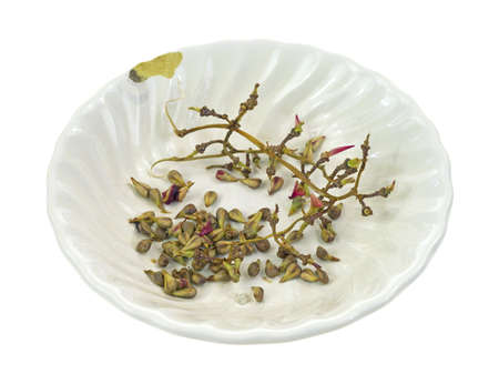 A small bowl used for discarded grape seeds and stems from seeded grapes  photo