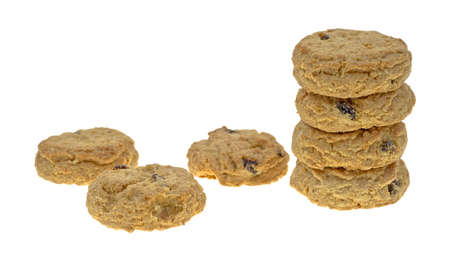A small stack of oatmeal raisin cookies with three to the side on a white background Stock Photo - 13506353