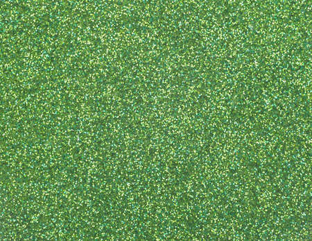 Close view of a surface with green glitter