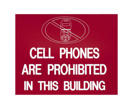 stating: A bold red sign stating cell phones are prohibited in building