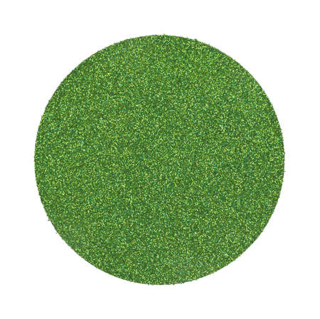 A large dot made of green glitter on a white background