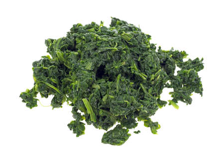 Large serving of chopped spinach on a white background  Reklamní fotografie