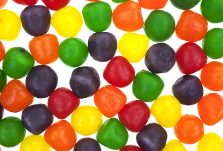 A very close view of sour balls against a white background