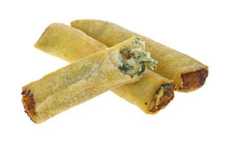 Tres de pollo y queso parmesano rollos de primavera con una mordida en un fondo blanco Foto de archivo - 13762178