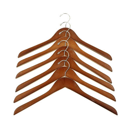 Several wood coat hangers arranged in a row on a white background Stock Photo - 13773496