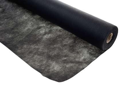 Landschap zwarte stof met de rol en de geopende doek op een witte achtergrond
