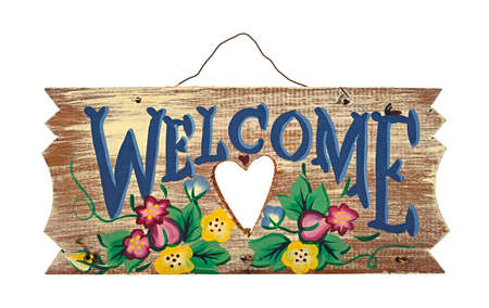 An old wood folk art Welcome sign on a white background  Stock Photo