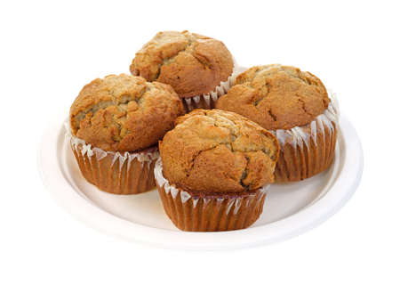 fresh  baked: Four apple spice muffins on a paper plate  Stock Photo