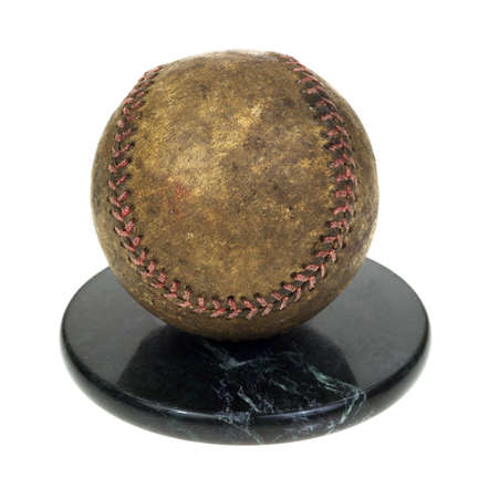 overly: A baseball that has been overly used on a granite base  Stock Photo