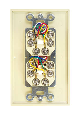 The back of a beige dual telephone outlet showing wires and screws on a white background  photo