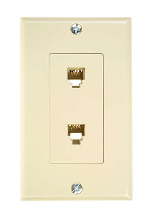 The front of a beige dual outlet telephone wall plate on a white background  photo