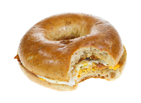 A wheat bacon egg and cheese bagel that has been bitten on a white background  photo