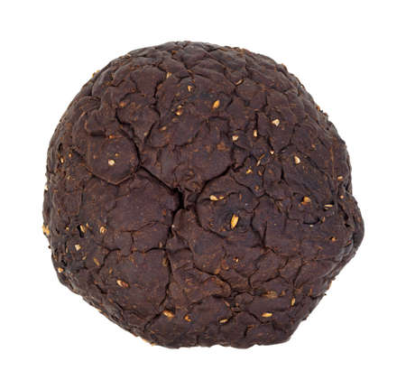 A loaf of round black rye bread on a white background  photo