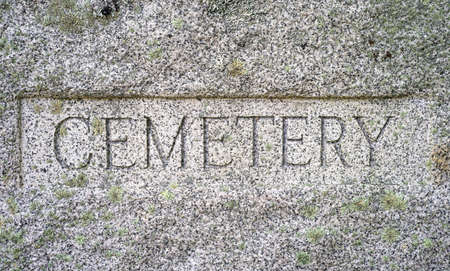 chiseled: A very old granite block with Cemetery chiseled in bold lettering  Stock Photo