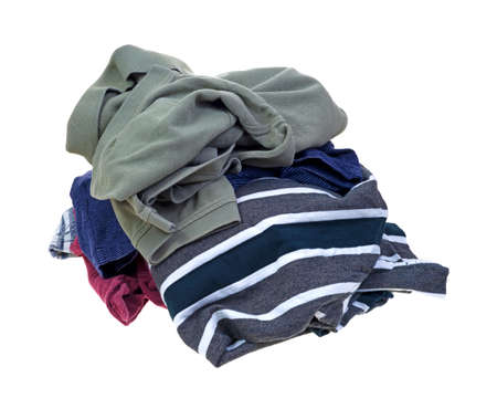Several dirty shirts in a pile on a white background  Stock Photo