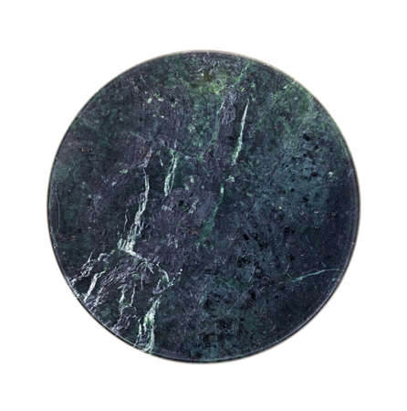A polished piece of round granite on a white background  photo