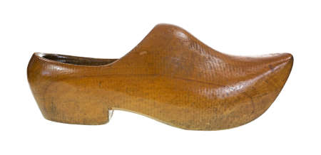 clog: Side view of an old pointed toed wood shoe on a white background