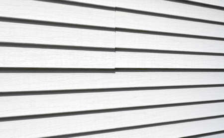 angled view: Angled view of white vinyl siding