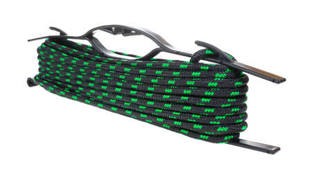 winder: A green and black rope looped in a black plastic winder on a white background