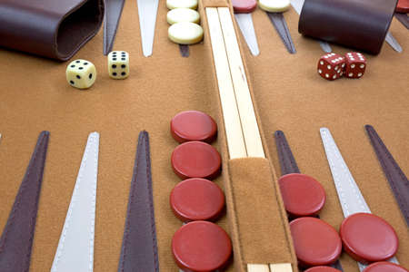 A very close view of a backgammon game in progress