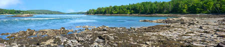 An extremely wide panoramic view of low tide at Tidal Falls in Hancock Maine